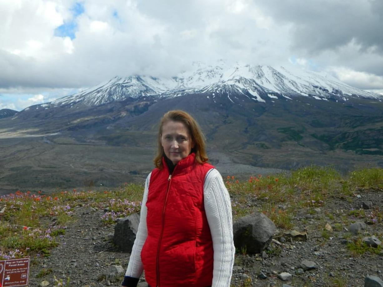 Author Melanie Holmes, with Mount St. Helens in the background. Holmes will give two talks on Saturday. Photo courtesy of Melanie Holmes