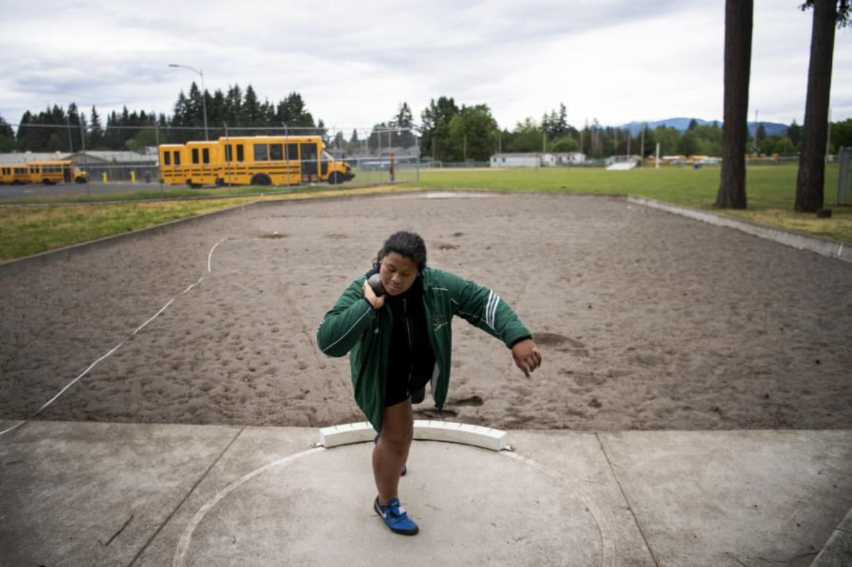 Evergreen junior Jasmine Tiatia sets up to throw during practice at McKenzie Stadium. The 3A district champion in the shot put has the top mark in 3A going into the WIAA state track and field championships this weekend.