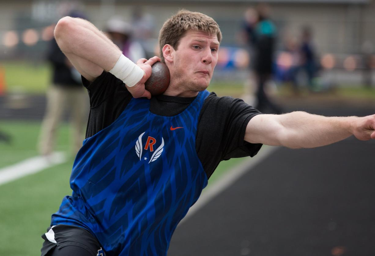 Ridgefield's Trey Knight competes in the boys shot put during the 2A District Track and Field Championships at Washougal High School, Friday, May 17, 2019.