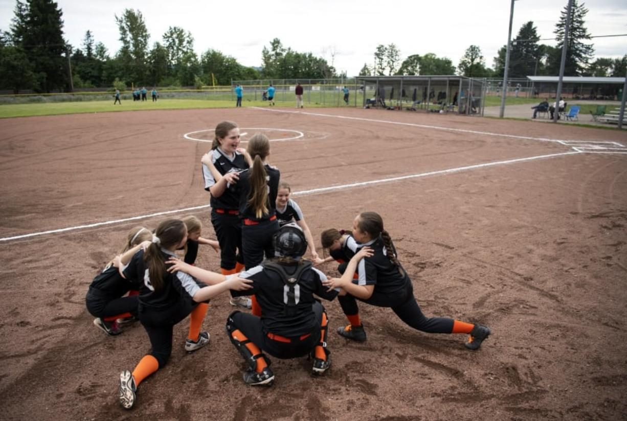The East County Warriors circle up for a cheer before their game at George Schmid Memorial Park in Washougal on Tuesday. While the complex sees plenty of action, there is no electricity, running water or lights, but the city received more than $1 million in the state budget to make upgrades at the field. Now, Washougal and East County Little League officials are figuring out how to raise the rest of the funds to build a third field, add lights and get amenities to the complex.