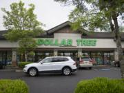 A motorist passes a Dollar Tree store along Northeast 162nd Avenue on Thursday afternoon, May 16, 2019. The Washington State Department of Labor & Industries announced Thursday a $503,200 fine against the store, alleging unsafe conditions.