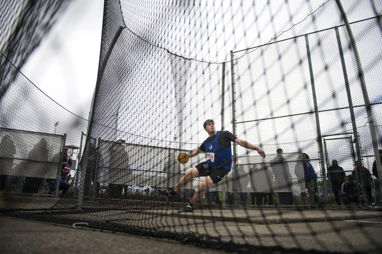 Ridgefield's Trey Knight completes a throw to win the state title during the 2A Boys Discus Throw at the WIAA state track meet at Mount Tahoma High School in Tacoma on Friday, May 24, 2019 (Nathan Howard/The Columbian)