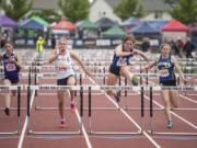Mountain View's Kate Kadrmas, center right, leads the pack to win the 3A Girls 100m Hurdles during the WIAA state track meet at Mount Tahoma High School in Tacoma on Friday, May 24, 2019.