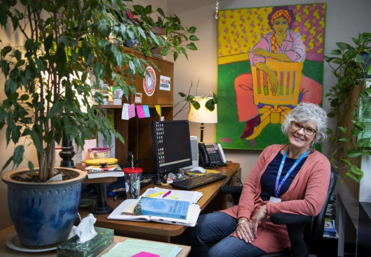 "Margo Priebe, a legal advocacy specialist at YWCA Clark County in Vancouver, fills her office with plants, paintings and things that bring her joy. ""It's really, really hard work, so you need to have a beautiful environment,"" she said. Priebe was a victim of domestic violence when she was a child and was drawn to the job to try to heal herself as well as others."