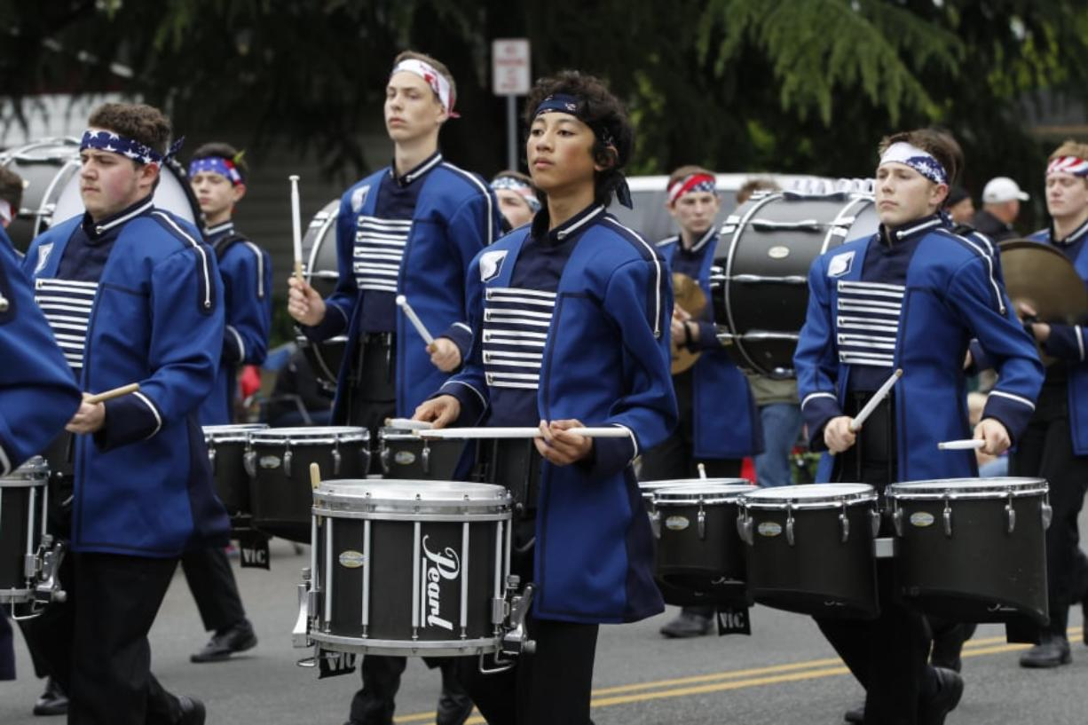 The Skyview high school band marches in a recent Hazel Dell Parade of Bands. The parade usually draws thousands of participants and tens of thousands of spectators.
