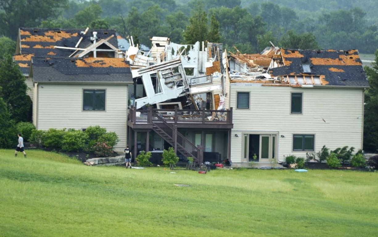 Tornado rips through Kansas City suburbs as storms move east