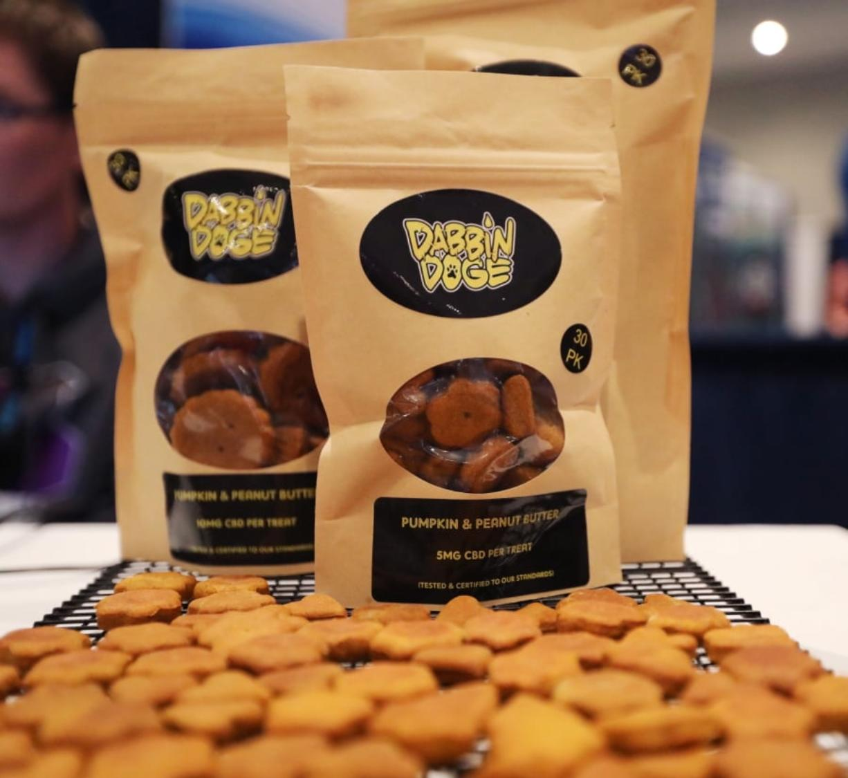 Dog treats are displayed at the Cannabis World Congress & Business Exposition trade show, Thursday, May 30, 2019 in New York. The treats contain non-psychoactive cannabidiol, CBD. They are marketed by DabbinDoge of New Providence, N.J. (AP Photo/Jeremy Rehm)