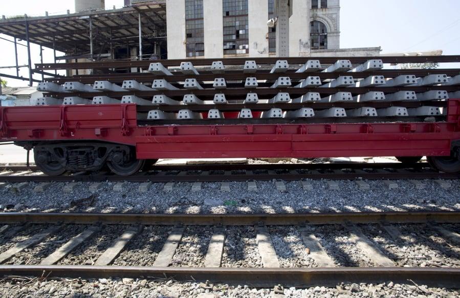 3cf203929426 Rails and cross ties that need repai sit atop railroad flat car, in Havana,