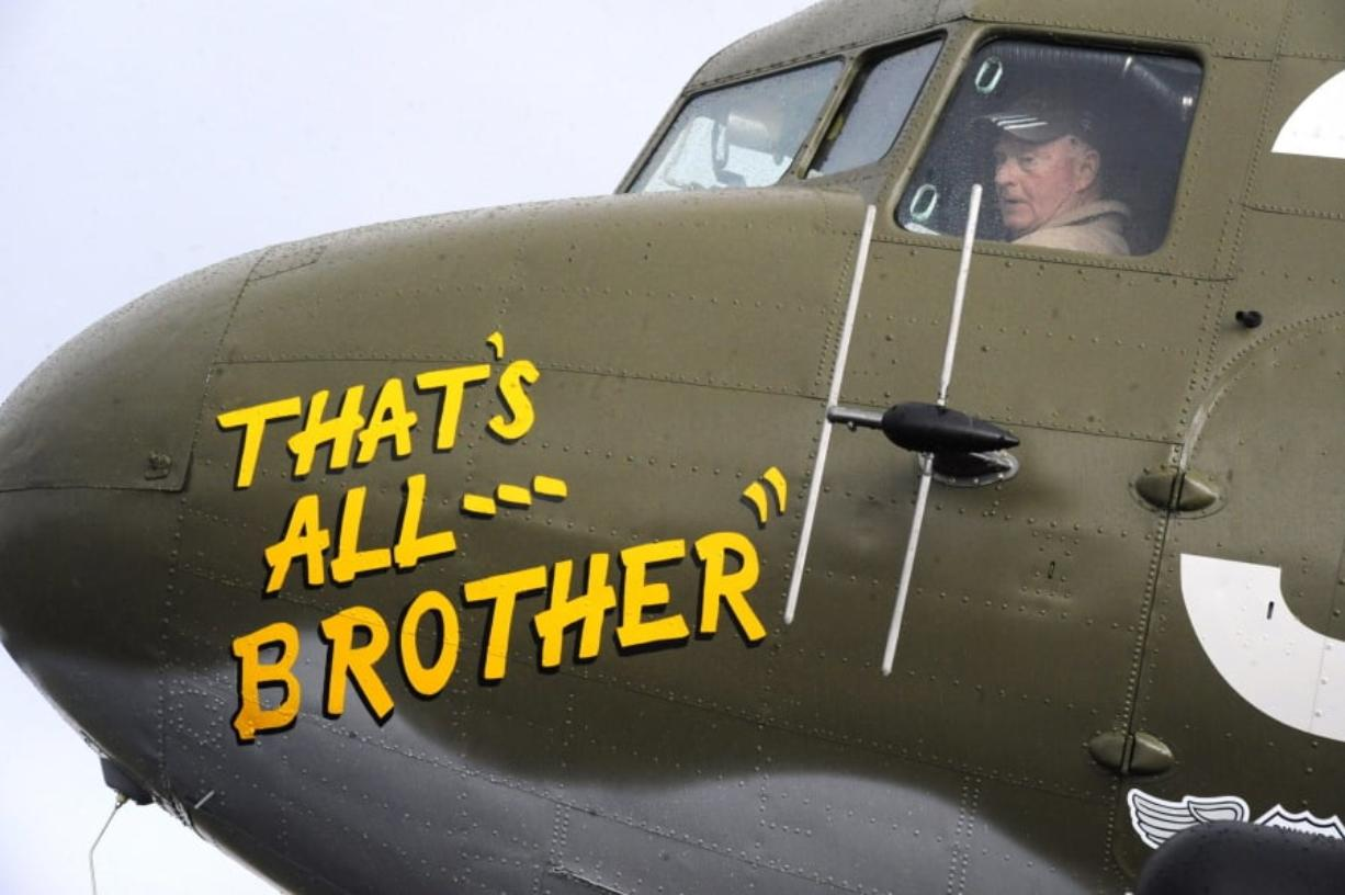In this April 9, 2019, photo, Pilot Tom Travis sits in the cockpit of the World War II troop carrier That's All, Brother during a stop in Birmingham, Ala. The C-47 aircraft, which led the main Allied invasion of Europe on June 6, 1944, is returning to the continent to participate in events marking the 75th anniversary of D-Day in June.