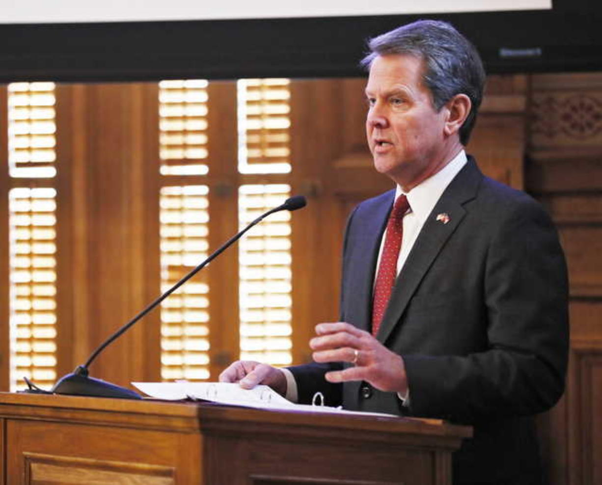 In this Wednesday, Jan. 23, 2019, file photo, Georgia Gov. Brian Kemp addresses the 2019 Season Joint Budget hearings, in Atlanta. Kemp is set to sign legislation on Tuesday, May 7, 2019, banning abortions at around six weeks of pregnancy, before many women know they're pregnant.