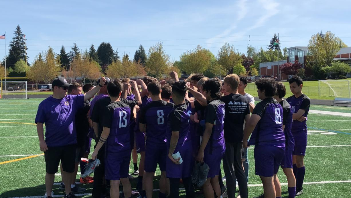 The Columbia River boys soccer team gathers after beating W.F. West 7-0 on Saturday in the first round of the 2A district tournament at Columbia River High.