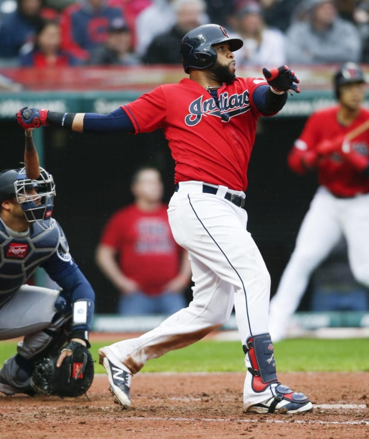 Cleveland Indians' Carlos Santana hits a two-run home run off Seattle Mariners relief pitcher Connor Sadzeck during the eighth inning of a baseball game, Saturday, May 4, 2019, in Cleveland. The Indians defeated the Mariners 5-4.