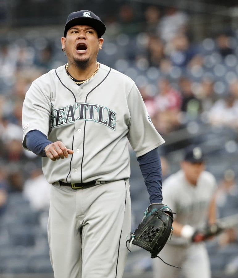 bf98c962f6e Seattle Mariners starting pitcher Felix Hernandez reacts while leaving the  mound after allowing a tw