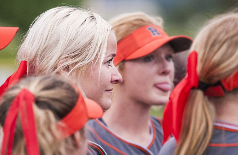 Ridgefield's Emma Jenkins listen to her coaches as tears well in her eyes following a 6-5 win over W.F. West in 2A district tournament play Friday at Longview's Seventh Avenue Park. (Joshua Hart/The Columbian)