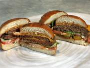 An Original Impossible Burger, left, and a Cali Burger, from Umami Burger, are shown in this photo in New York, Friday, May 3, 2019. A new era of meat alternatives is here, with Beyond Meat becoming the first vegan meat company to go public and Impossible Burger popping up on menus around the country.