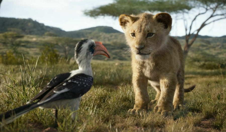 """Zazu, voiced by John Oliver, left, and Simba, voiced by JD McCrary, in """"The Lion King,"""" directed by Jon Favreau."""