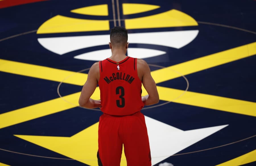 a782e260654 Portland Trail Blazers guard CJ McCollum stands at center court waiting for  the start of the