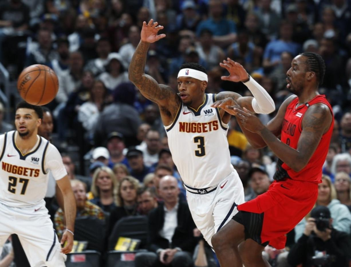 Denver Nuggets forward Torrey Craig, left, and Portland Trail Blazers forward Al-Farouq Aminu pursue the ball during the first half of Game 2 of an NBA basketball second-round playoff series Wednesday, May 1, 2019, in Denver.