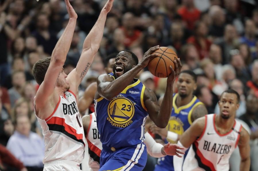 3f03c685f10 Golden State Warriors forward Draymond Green (23) shoots against Portland  Trail Blazers forward Meye