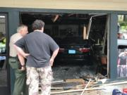The driver of a dark-colored Toyota Camry reportedly mistook the gas pedal for the brake while attempting to park in front of Bortolami's Pizzeria, a news release said. Firefighters put the car into neutral and rolled it back, freeing the pinned woman. (Clark Co.