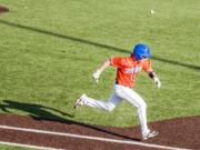 Ridgefield's Clay Madsen tries to beat out a throw in a 2A district championship baseball game Friday at Propstra Stadium. Ridgefield won 4-2.