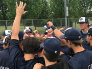 Skyview's baseball team celebrates its 1-0 regional-final win over Eastlake in Puyallup to advance to next week's state semifinals. The Storm won a pair of 1-0 games Saturday.