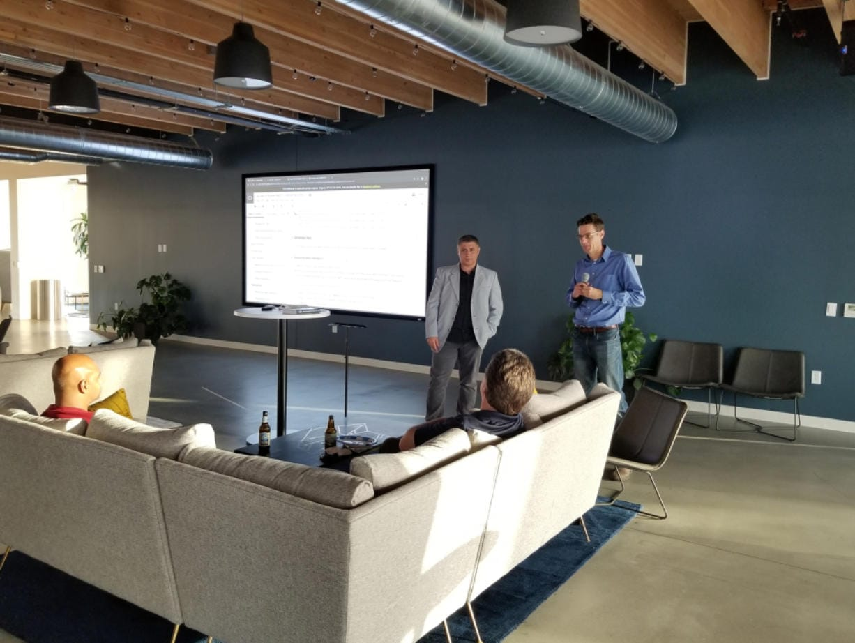 Manceps CEO Al Kari, left, and senior NLP architect Hobson Lane lead a demonstration to see if artificial intelligence could be used to decipher the redacted portions of the Mueller Report.