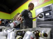 Michael Swadberg turns in bottles at a Bottledrop Oregon Redemption Center on July 31, 2015, in Gresham, Ore. Over the last year, reports of people rummaging through recycling bins have increased in Clark County. The target of these scavengers has been discarded bottles and cans, which have become increasingly valuable on the other side of the Columbia River. While local governments in Clark County have limited tools and their efforts are just starting, they could soon get help from Oregon. Last week, the Oregon Legislature passed a bill that's intended to deter people seeking to cash in on out-of-state containers.