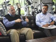 Bill McMahon, former Nautilus Inc. chief operating officer, left, talks about the company with Sid Nayar, chief financial officer, who is leaving the company.