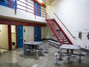"""The Clark County Jail's high-security wing. The jail was built in the 1980s and designed for an indirect supervision model, with deputies physically separated from inmates. As part of the renovations, jail staff are hoping to move to a direct supervision model. """"The change to direct supervision means a calmer atmosphere,"""" Clark County Jail Chief Ric Bishop said."""