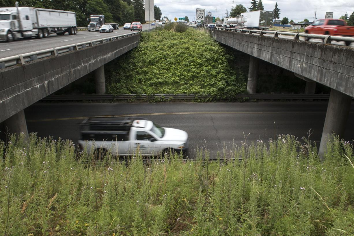 Traffic drives past the 179th Street and I-5 interchange. (Nathan Howard/The Columbian files)