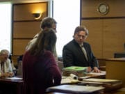 Attorney Shon Bogar takes the stand with a client at Clark County Superior Court in Vancouver on May 7.