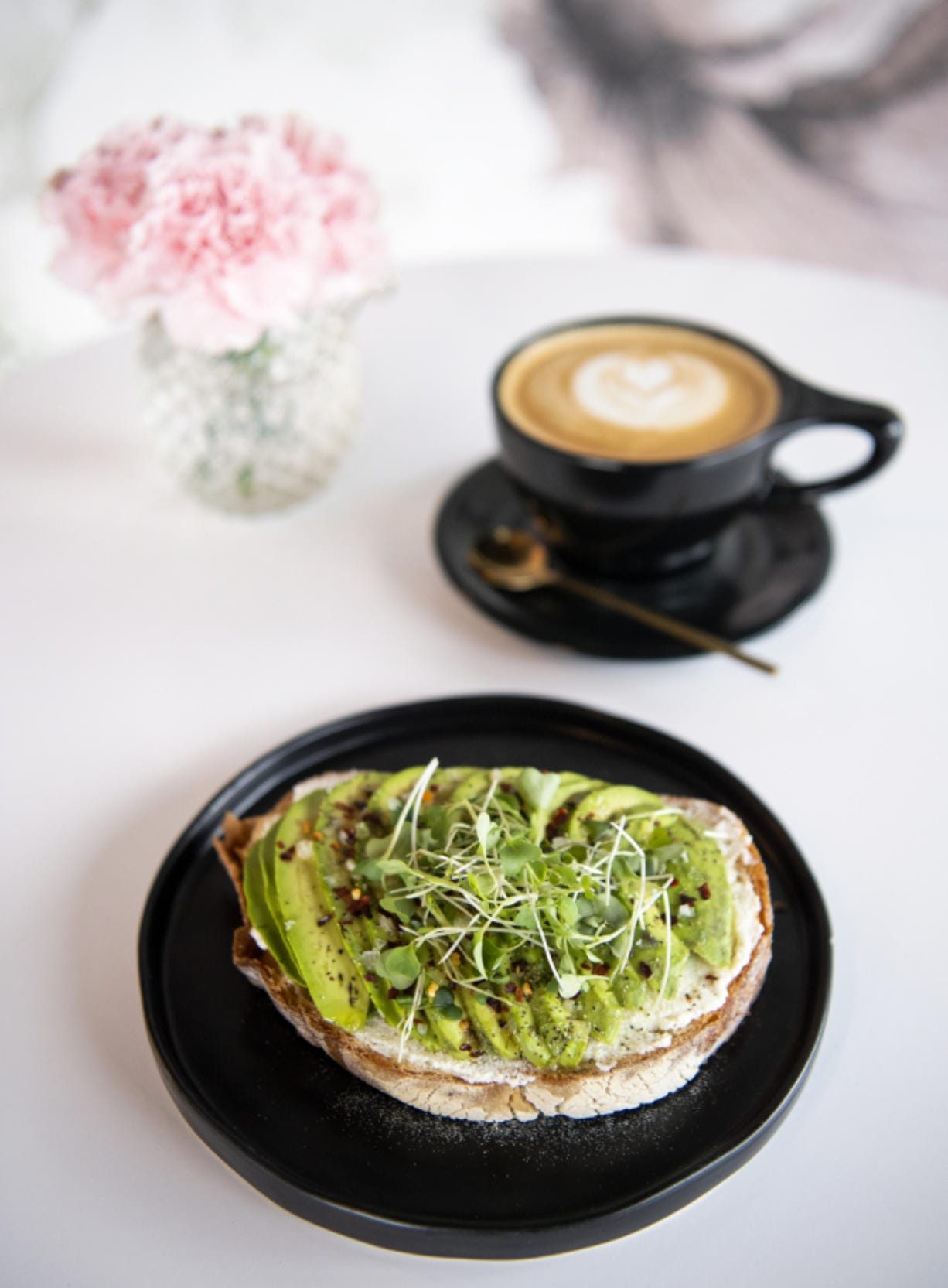 The avocado toast at Presso Coffee Kitchen. The rustic white bread is topped with ricotta cheese, avocado, olive oil, lemon juice, salt, pepper, chili flakes and micro greens. Alisha Jucevic/The Columbian