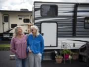 "Glenda Peck, left, and her mother, Edith Perrone, are next-door neighbors at the new Ridgefield Fairgrounds RV Park in Ridgefield. They were two of the first people to move into the park when it opened earlier this month, and they got spots right next to each other. ""We talk out the window to each other when it's cold,"" Peck joked."