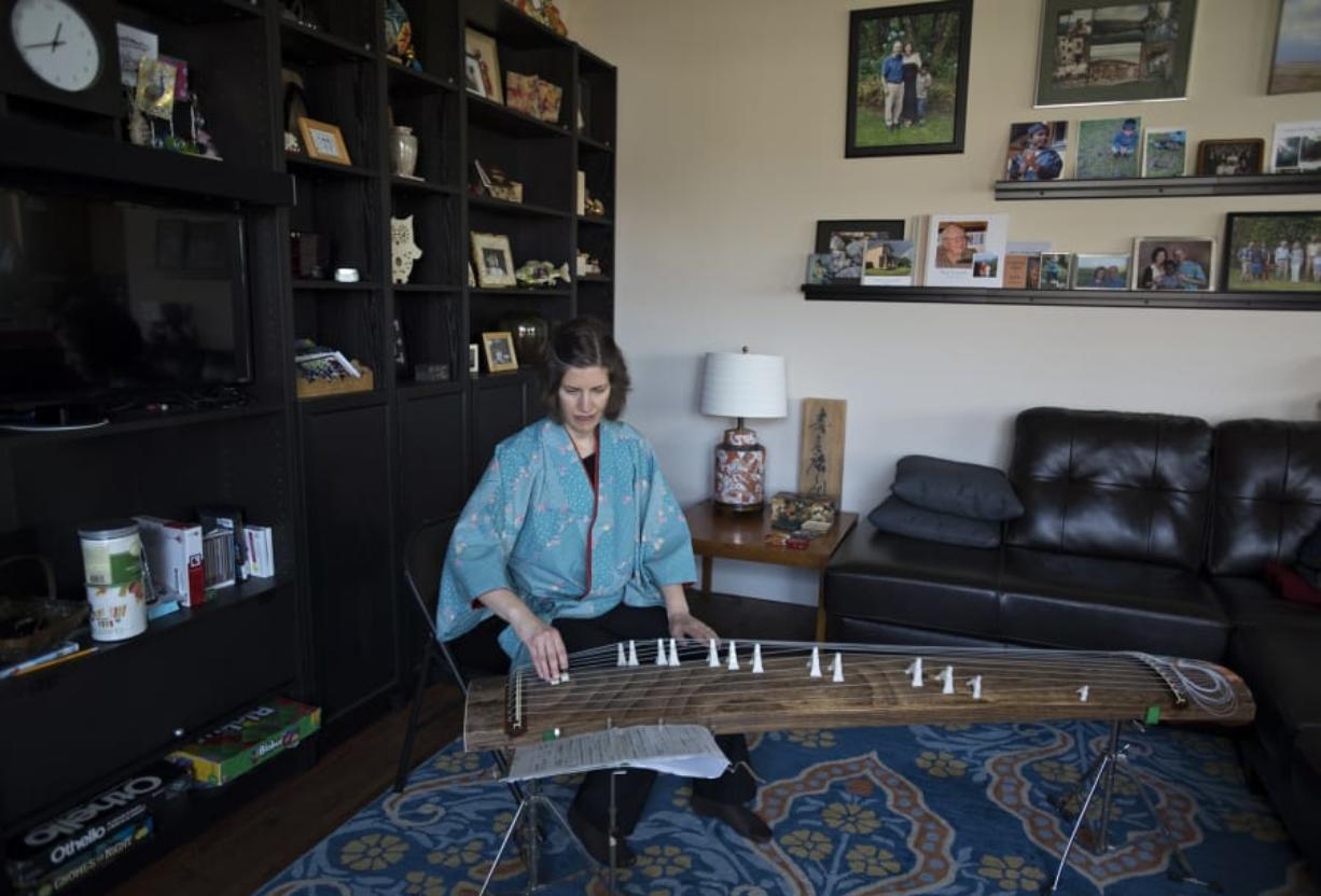 Sarah Coomber, who spent years teaching in Japan, plays the koto, or Japanese zither, at her home near Five Corners. Coomber is the author of a new memoir about her time spent in Japan.