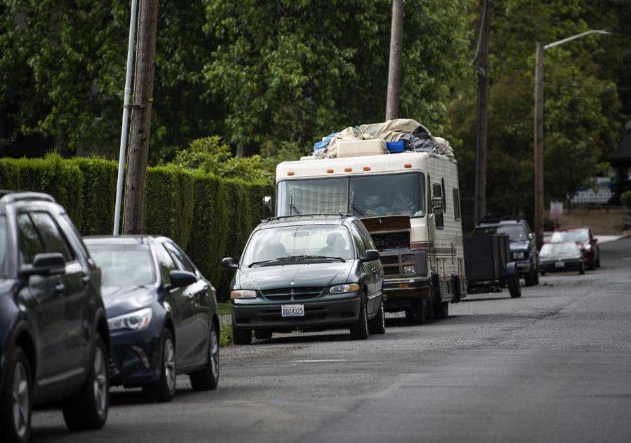 An RV is parked outside the entrance of the Hazel Dell RV Park in Vancouver on June 6. The sight of such vehicles often prompts complaints to county officials.