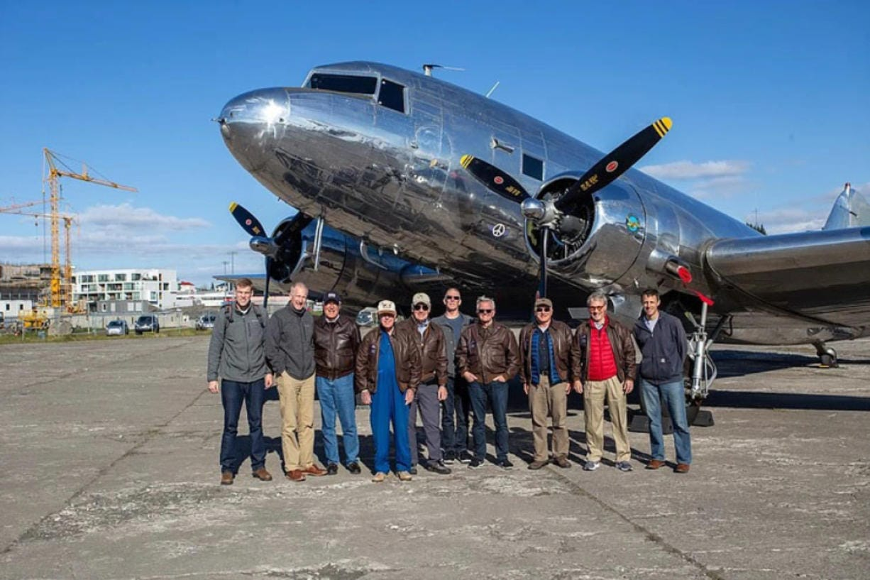 The 11 passengers on a trip from Aurora, Ore., to Normandy, France, in honor of the D-Day anniversary. Two Clark County residents were on the trip: Bob Irvine, fourth from left, and Jeff Petersen, sixth from left.