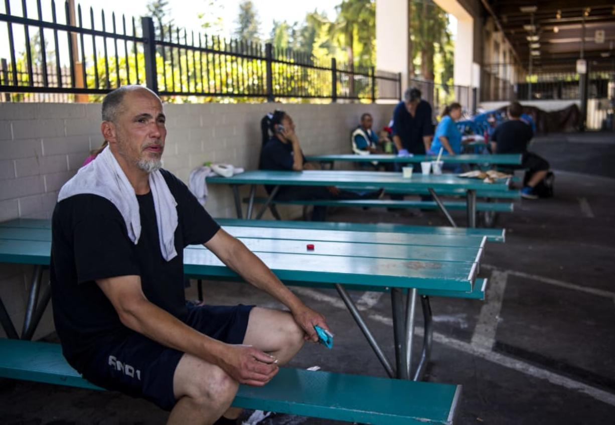 """Charles Casey Thompson sits outside the Vancouver Navigation Center for a smoke on Tuesday. Thompson said he thinks the center is an asset for the homeless community, but also the Vancouver community as a whole. """"It keeps the germs and disease down,"""" he said. The Vancouver Navigation Center provides laundry and showers, among other services, to people in need of resources."""