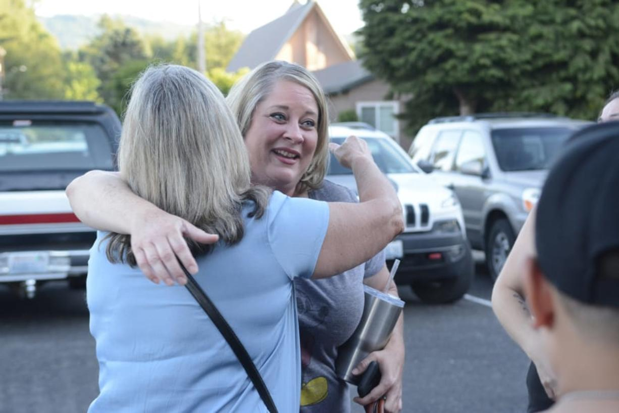 Shauna Walters of Battle Ground hugs a supporter outside Yacolt Town Hall after the town council voted to declare itself a sanctuary from Initiative 1639, a gun measure state voters passed in November.