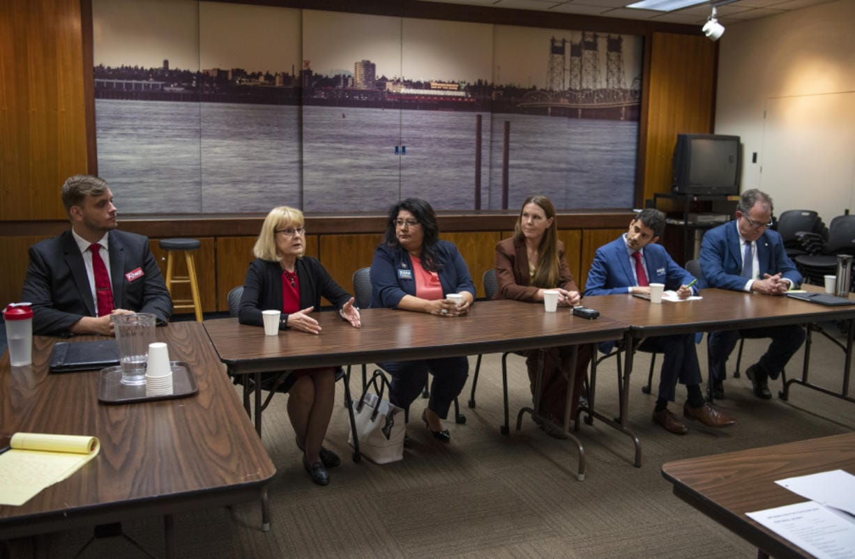 Six of the seven candidates for Vancouver City Council Position 6 meet with The Columbian's Editorial Board on Tuesday: Mike Pond, from left, Jeanne Stewart, Diana Perez, Sarah Fox, Adam Aguilera and Paul Montague. Not pictured is Dorel Singeorzan, who was unable to attend the meeting.