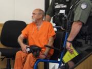 David Croswell, who's accused of driving a Jeep onto the beach of a Washougal swimming hole, striking and killing two people, makes a first appearance at Clark County Superior Court in Vancouver in June 2019.