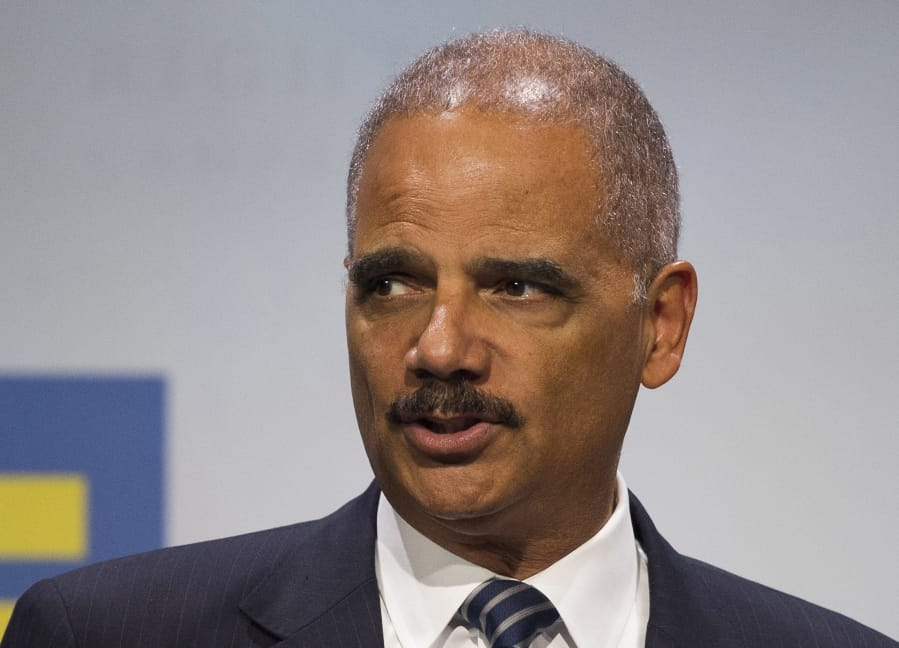 FILE - In this Sept. 15, 2018 file photo, former Attorney General Eric Holder addresses the Human Rights Campaign National Dinner in Washington, D.C. Virginians will elect members of the House of Delegates this year using a map seen as favorable to Democrats, according to a ruling Monday, June 17, 2019 by the U.S. Supreme Court. The lawsuit challenging the original House lines was backed by the National Democratic Redistricting Committee, led by former U.S. Attorney General Eric Holder.