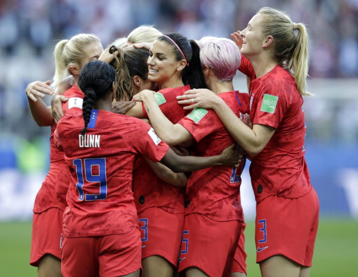 United States' Alex Morgan, center, celebrates after scoring the opening goal during the Women's World Cup Group F soccer match between United States and Thailand at the Stade Auguste-Delaune in Reims, France, Tuesday, June 11, 2019.