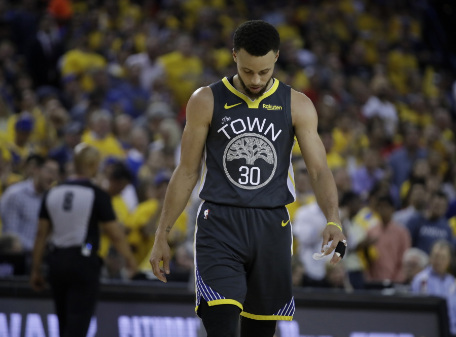 f4df20d0241 Golden State Warriors' Stephen Curry walks on the court during a timeout in  the second