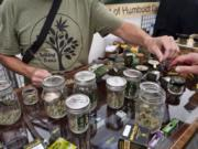 A vendor with Talking Trees Farms a Northern Humboldt County sustainable cannabis farm offers a taste of their latest crop of crafted marijuana flower to an attendee of WeedCon West 2019 in Los Angeles on June 20. Experts recently dubbed cannabis the fastest-growing industry in the U.S.