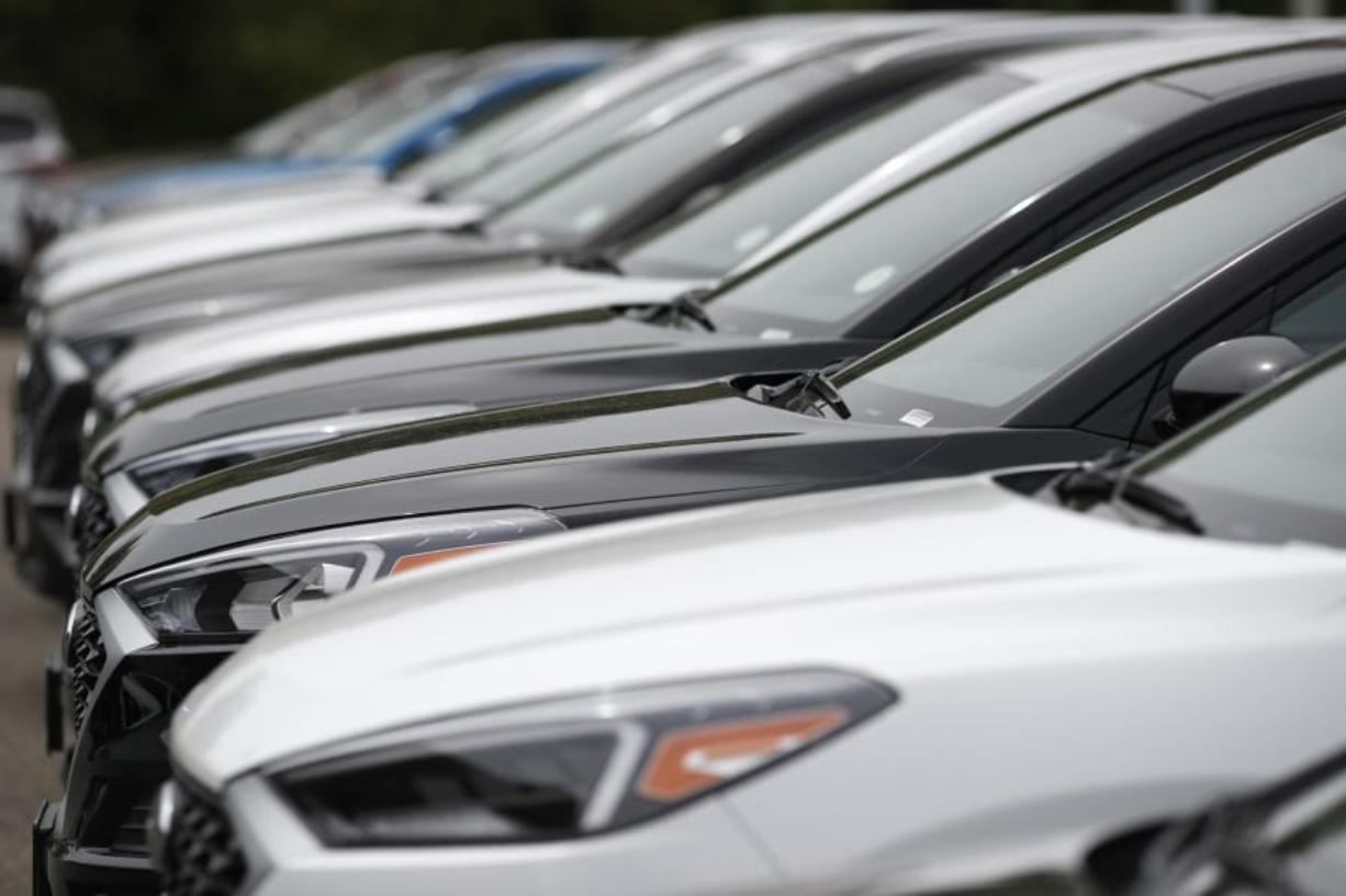 With the cost to own a new vehicle rising, it's more important than ever to consider what you'll pay for a car loan and to shop for the best interest rate. (AP Photo/David Zalubowski, File)
