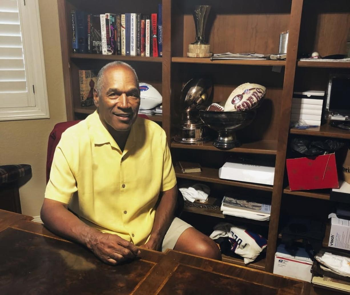 O.J. Simpson in his Las Vegas area home Thursday. After 25 years living under the shadow of one of the nation's most notorious murder cases, Simpson says his life now is fine.