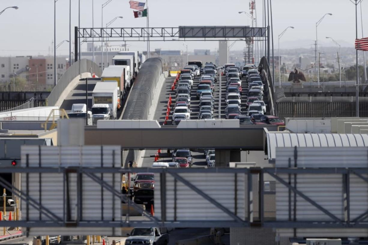 FILE - In this March 29, 2019, file photo, cars and trucks line up to enter the U.S. from Mexico at a border crossing in El Paso, Texas. Authorities in far South Texas say U.S. Border Patrol agents have discovered the bodies of four people, including three children, who appeared to have died from heat exposure after crossing the Rio Grande. Hidalgo County sheriff's Sgt. Frank Medrano said the bodies of a woman in her early 20s, a toddler and two infants were found Sunday, June, 23, 2019, in or near Anzalduas Park, which borders the river in the city of Mission.