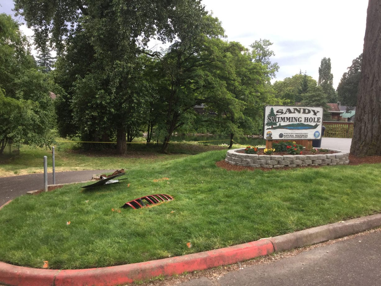 Two people died Tuesday afternoon after a Jeep tore through Sandy Swimming Hole Park in Washougal.