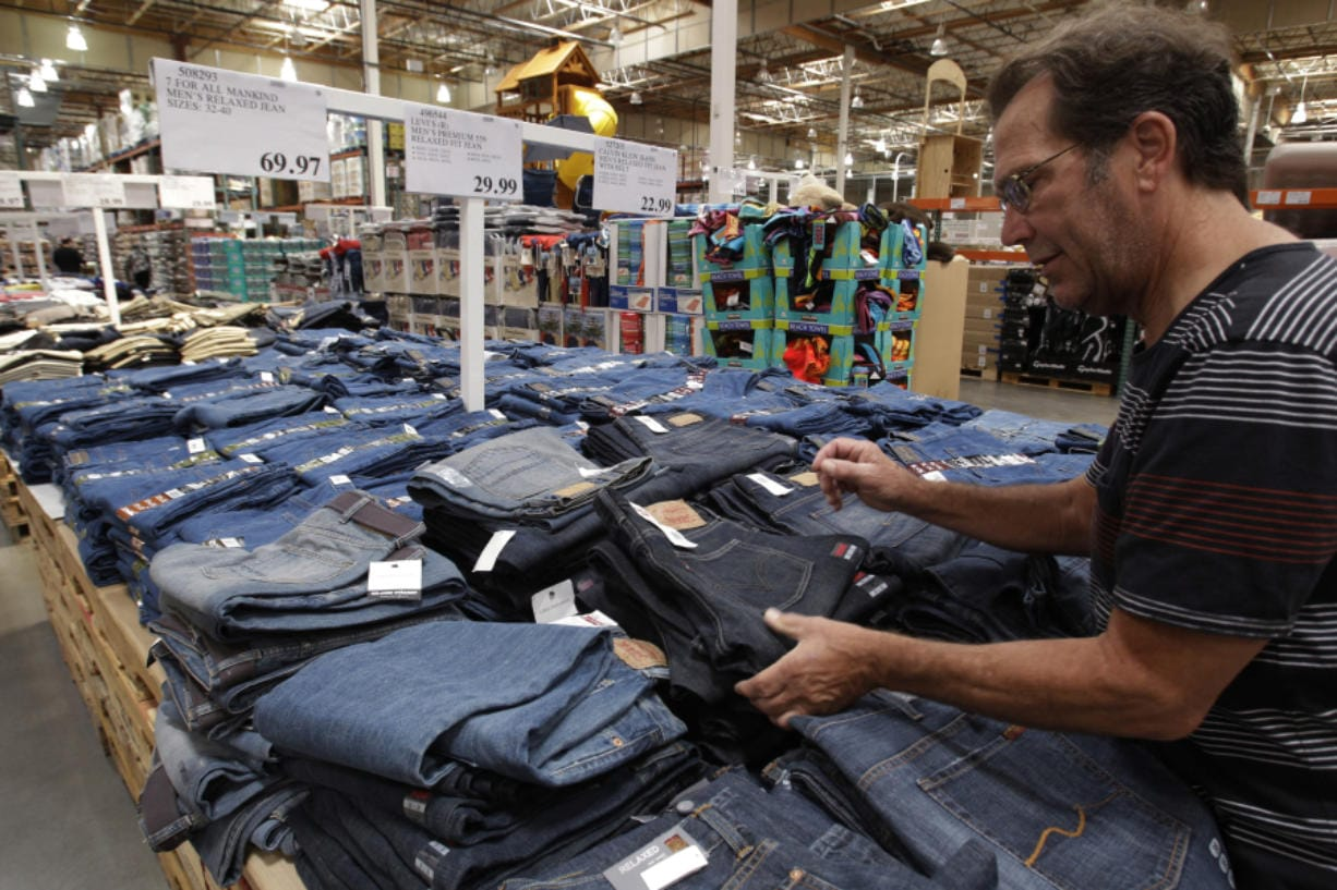 A shopper looks at jeans at Costco in Mountain View, Calif.